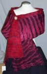 Red and black pole dyed shibori stole.