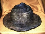 Black hat with a silk cap felted in.