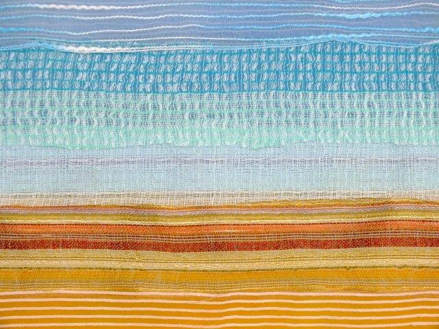 close up of fabrics on top of merino wool base layers