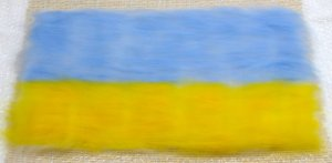 one fine layer of blue and yellow merino wool over 2 fine white base layers of white merino wool